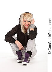 Urban dancer sitting in studio - Beautiful, happy young...