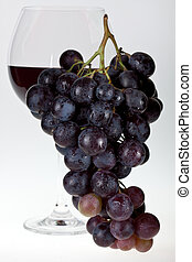 Wine grapes and red wine - Redwine and wine grapes.