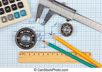 technical tools on a background of graph paper