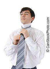 Businessman tying his tie Isolated on white background