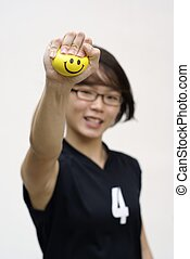 Asian lady squeezing happy ball