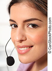 Receptionist portrait with headset - Close up headshot of...