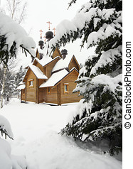 wooden church on a snowy meadow