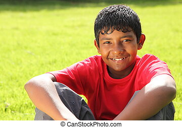 Teenage boy sitting in sunshine - Young teenage boy, 13,...