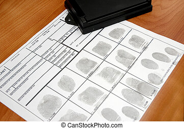 IDcard - ID card with fingerprints on table