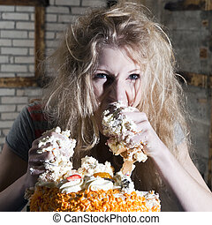 Gluttony - Young woman, ravaging a cake with both hands,...