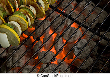 Charcoal Grill Coals and Vegetable Skewers - Skewered yellow...