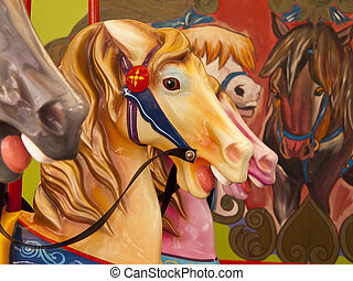 Colorful Horses On Carousel - Several of the plastic horses...