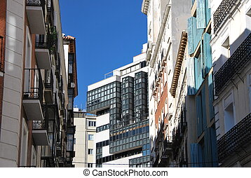 Streetview of Madrid, Spain - View of buildings in a narrow...