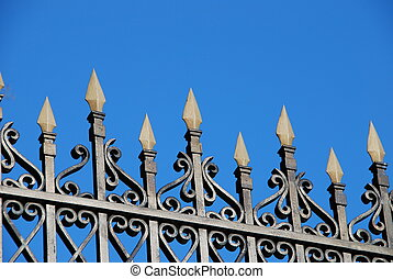 Wrought iron fence - Close-up of a wrought iron fence over a...