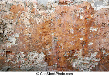 Wheathered Cob Wall - wheather-beaten wall made of clay and...