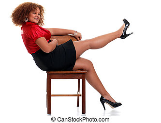 african woman on a chair