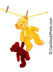 Teddy bear on clothes line rescuing - isolated Teddy bear on...