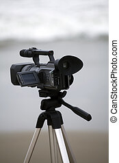 Video camera on tripod at the beach