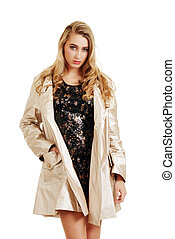 teenager in a beige rain coat - isolated teenager in a beige...