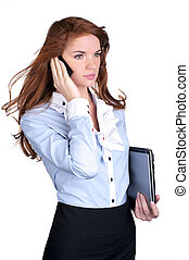 Young female executive talking on cellphone