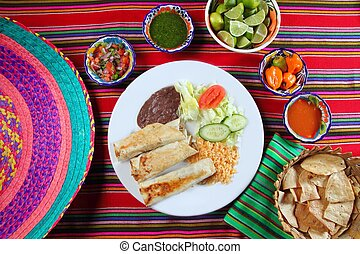 Burritos mexican rolled food rice salad and frijoles Mexico...