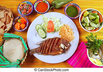 fried mojarra tilapia fish Mexico style with chili sauce and...