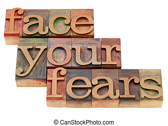 face your fears phrase in letterpress type - face your fears...