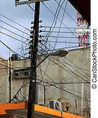 messy electric cables wooden pole busy skyscape