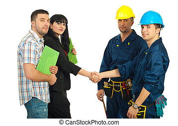 Couple and workers team agreement - Mid adult couple and...