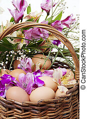 Basket full of Easter eggs and flower closeup