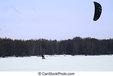 snow kiting on a frozen lake