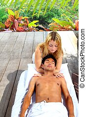 massage therapy stretch head neck outdoor in rainforest...