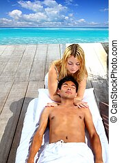 massage therapy stretch head neck outdoor Caribbean beach