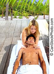 massage therapy stretch head neck outdoor palm trees...