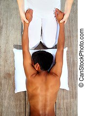 massage therapy stretch shiatsu on wooden floor outdoor