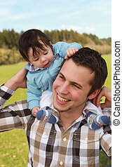father son - A young happy father 25 years with his 4 month...