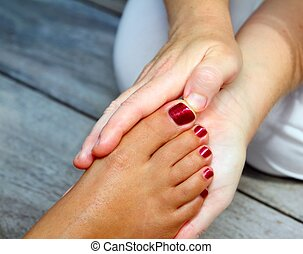 Reflexology woman feet massage therapy outdoor