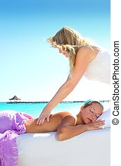 Caribbean turquoise beach massage woman
