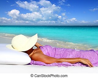 Caribbean tourist resting beach hat woman