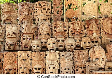 Mayan wood mask rows Mexico handcraft faces indian culture