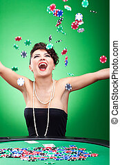 throwing chips in the air - very happy casion lady winning...
