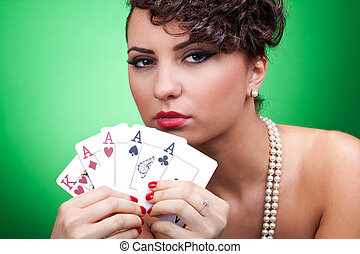 good hand in poker - four aces - closeup of a sexy woman...
