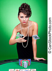 woman winning at poker table - sexy woman throwing the ace...