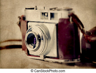 Old fashioned photography camera isolated over a white...