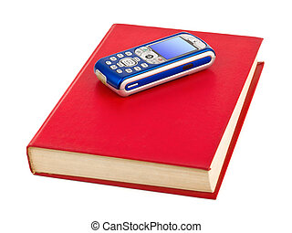 Mobile phone on book isolated on white background