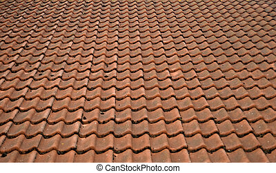 Red tiling - Roof of a house covered with old red tiling