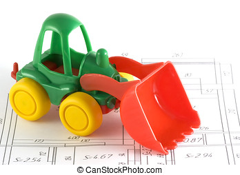 toy excavator on a plan