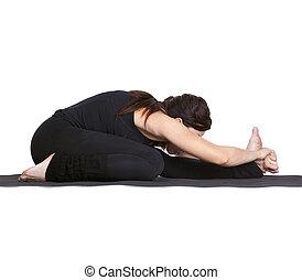 yoga excercising Janu shirshasana - full-length portrait of...