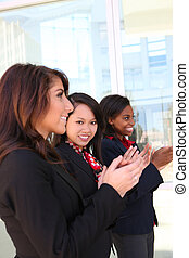 Woman Business Team Clapping - A diverse attractive woman...
