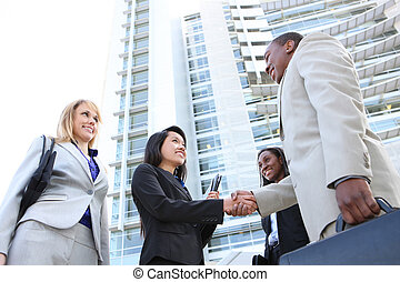 Man and Woman Business Team - A diverse attractive man and...