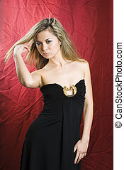Pretty woman - Young woman in black dress on red background