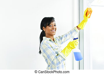 Smiling woman cleaning windows - Smiling black woman...