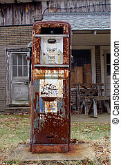 Antique American gas pump Rusted and with chipped off paint...