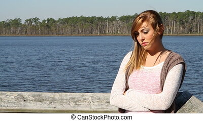 Lonely Depressed Teen By Lake - Lonely depressed teen stands...
